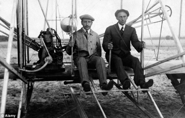 Wilbur Wright and Orville Wright on the Wright Flyer I in 1910.