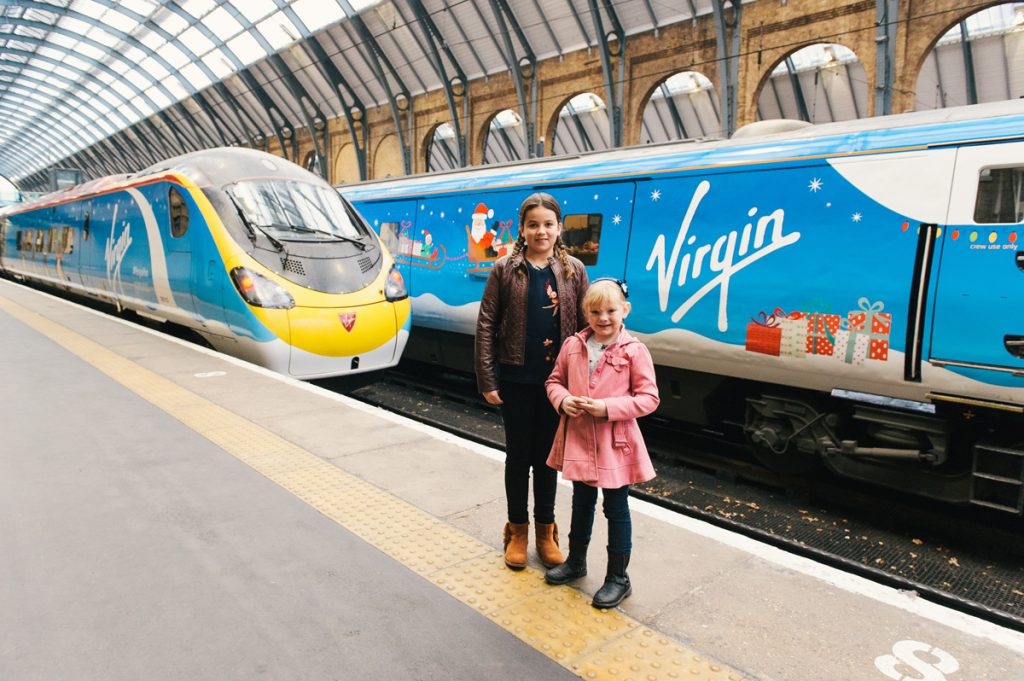 Designs by 9 (Amber Maxfield) and 11 (Madeleine Deakin) year olds revealed at King's Cross Station. Image courtesy of Virgin Trains Group.