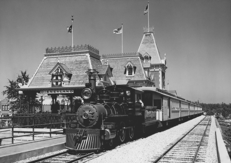 The Santa Fe and Disneyland Railroad pulling into Main Street Station USA in 1960.