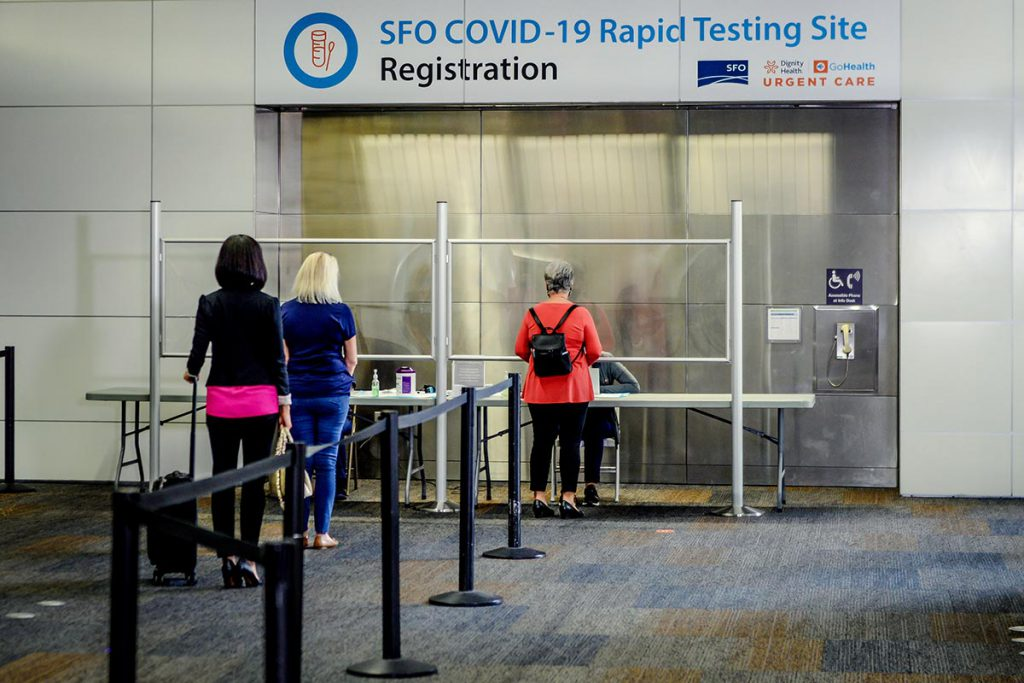 Passengers lining up for their pre-booked rapid COVID-19 test on site at San Francisco International Airport.