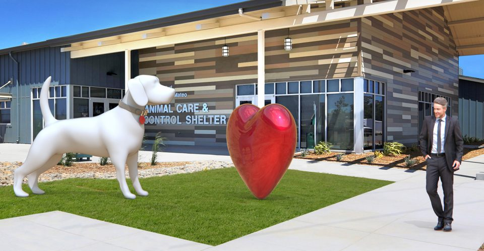 Oversided sculpture of a big white dog and large red heart.