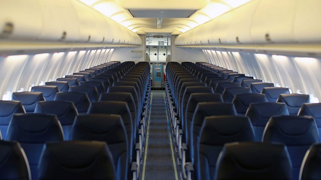 Plane interior with blue seats.
